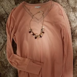Peach colored top with sparkling neckline.